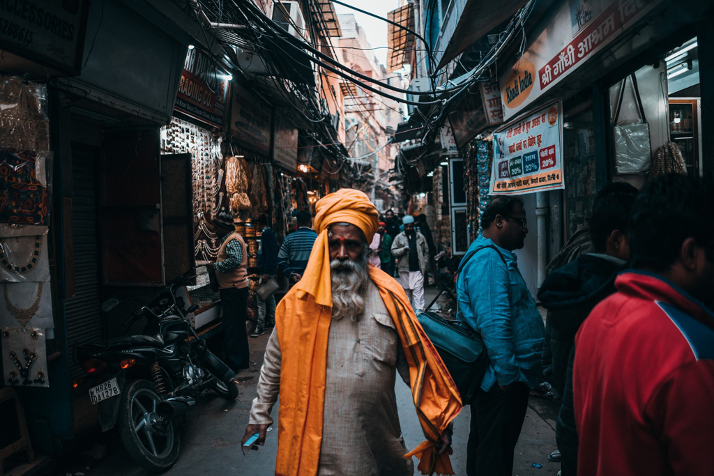 India man in yellow robes in New Delhi