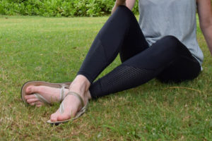Close up of earth runners on feet with black leggings