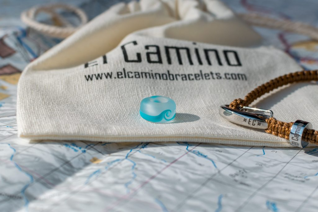 Close up of the Mediterranean Sea step with the El Camino bracelet and its packaging
